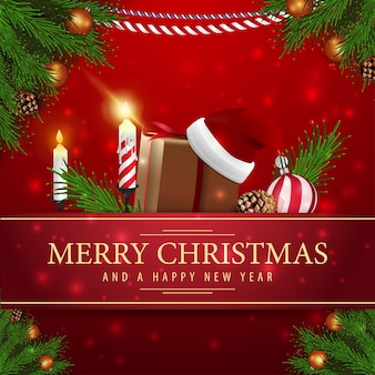 Rode kerstkaart met giften van kerstmis en kaars Premium Vector