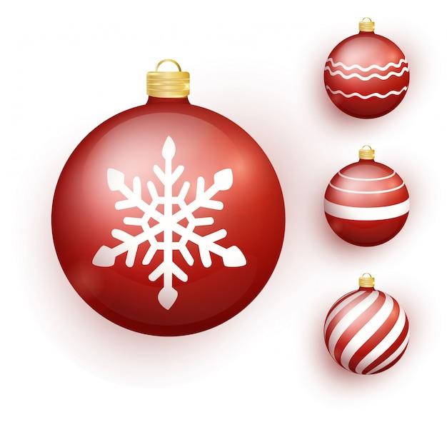 Rode kerstmisbal die met sneeuweffect wordt geplaatst.