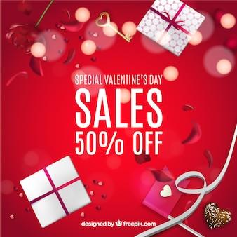 Rode verkoop achtergrond met valentijn cadeaus