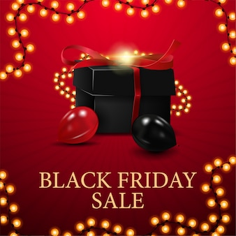 Rode vierkante kortingsbanner voor black friday. korting met zwart cadeau, ballonnen en slingerframe