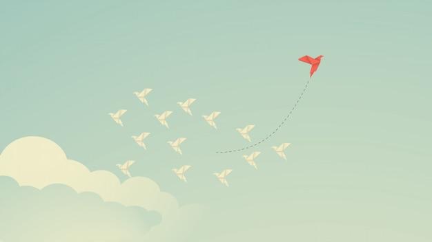 Rode vogel die van richting verandert en witte. nieuw idee, verandering, trend, moed, creatieve oplossing, business, innovatie en uniek manierconcept