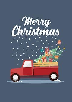 Rode vrachtwagen met een kerstboom