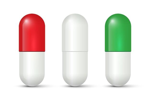 Rode, witte en groene capsulepillen die op witte achtergrond worden geïsoleerd.