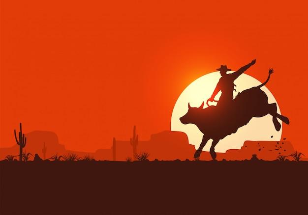 Rodeo cowboy rijdende stier bij zonsondergang,
