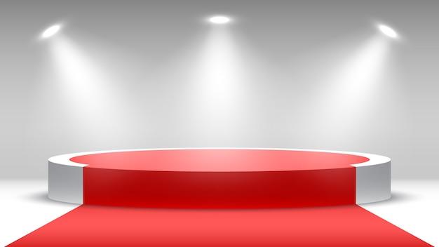 Rond podium met rode loper voetstuk met schijnwerpers