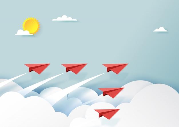 Rood document vliegtuigengroepswerk die op blauwe hemel en wolk vliegen.