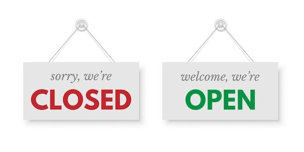 Rood gesloten en groen open uithangborden opgehangen aan zuignap