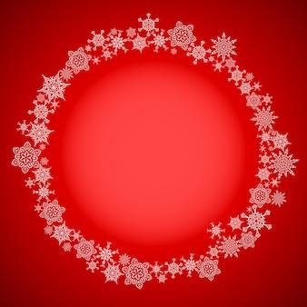 Rood kerstmisframe met sneeuwvlokkencirkel