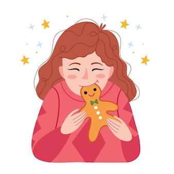 Roodharig meisje eet een peperkoekman. winterstemming.