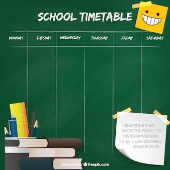 Rooster op het schoolbord en boeken met potloden