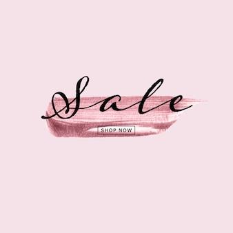 Rose goud handgeschilderde penseelstreek met verkoop tekst op roze achtergrond.