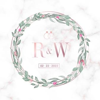 Rose gouden cirkelframe met bloemen op marmer voor bruiloft monogram logo en uitnodigingskaart