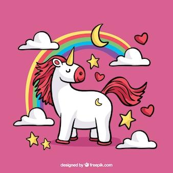 Roze achtergrond met eenhoorn en regenboog