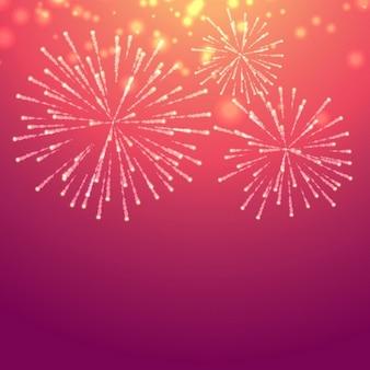 Roze achtergrond met vuurwerk viering