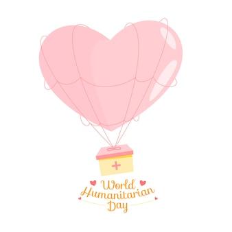 Roze ballon met gezondheidsdoos met concept wereld humanitaire dag.