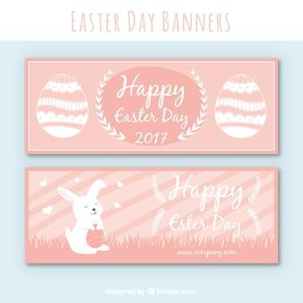 Roze pasen banners met konijn en eieren
