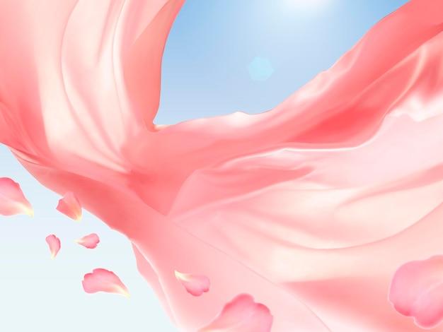Roze zwevende stof, romantische designelementen, zijde en gladde textuur op blauwe hemelachtergrond