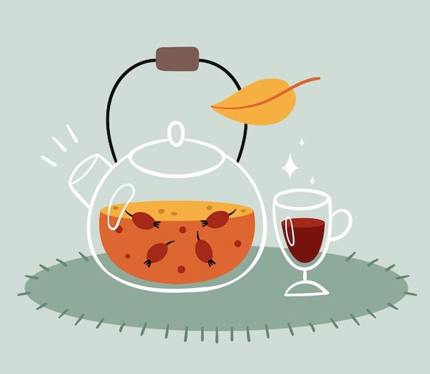 Rozenbottelthee in een transparante theepot. een glaasje glühwein. warme herfstdrank.