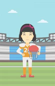 Rugbyspeler met bal en helm in handen.