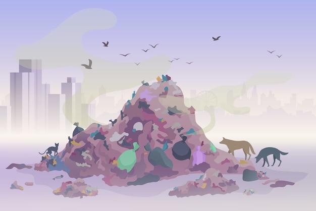 Ruikend stortplaatsafvallandschap met stadswolkenkrabbers op de achtergrond. verontreiniging milieu concept