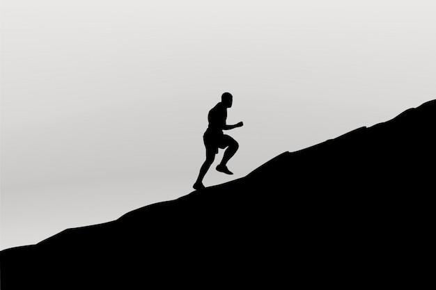 Runner silhouet in de bergen