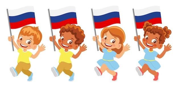 Rusland vlag in de hand. kinderen die vlag houden. nationale vlag van rusland