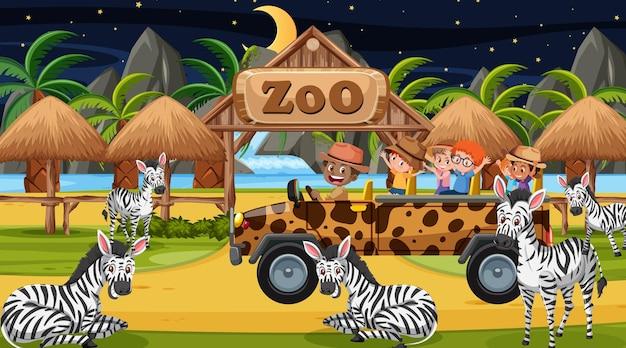 Safari bij nachtscène met kinderen die naar zebragroep kijken