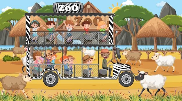 Safari overdag met kinderen die naar de schapengroep kijken