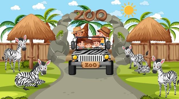 Safari overdag met kinderen die naar zebra's kijken