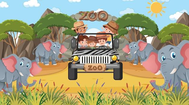 Safari overdag met veel kinderen die naar de olifantengroep kijken