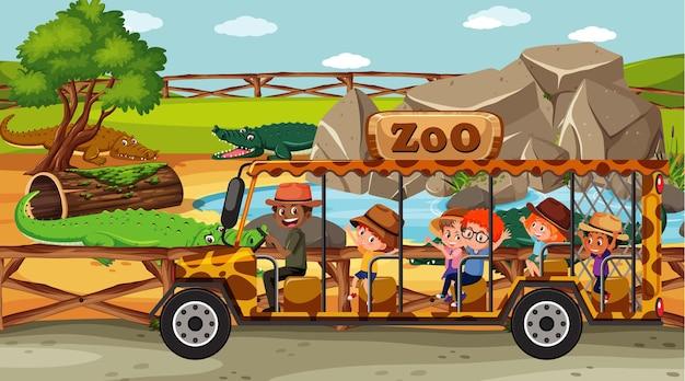 Safariscène met kinderen die naar krokodillengroep kijken