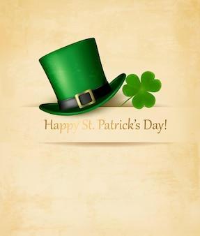 Saint patrick's day achtergrond met kruidnagelblad en groene hoed.