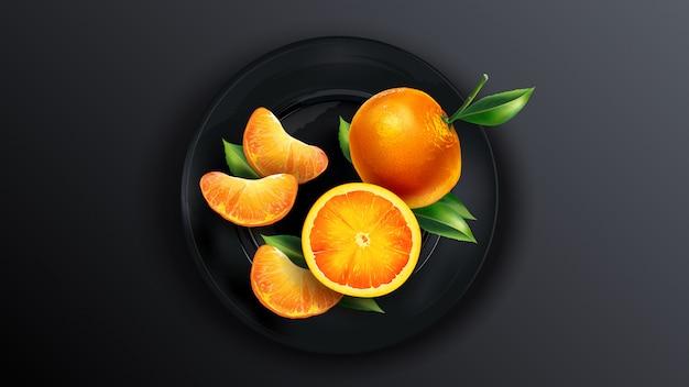Samenstelling van mandarijnen op een zwarte plaat.