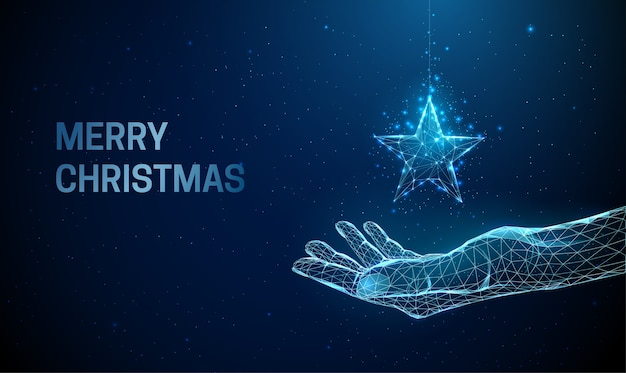 Samenvatting die hand met kerstmisstuk speelgoed ster geeft. laag poly-stijl ontwerp. vrolijke kerstkaart. moderne 3d grafische geometrische achtergrond. lichte verbindingsstructuur van draadframe. geïsoleerd