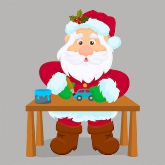 Santa claus die in zijn workshop speelgoed maakt