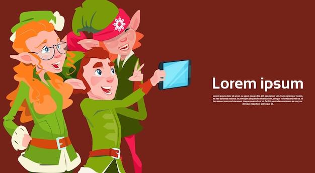 Santa claus helper green elf group making selfie photo