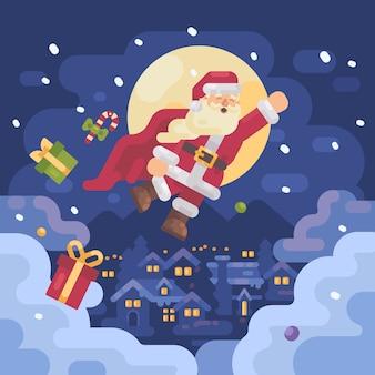 Santa claus vliegt over een besneeuwde berg