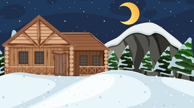 Scène met blokhuis op het sneeuwgebied bij nacht