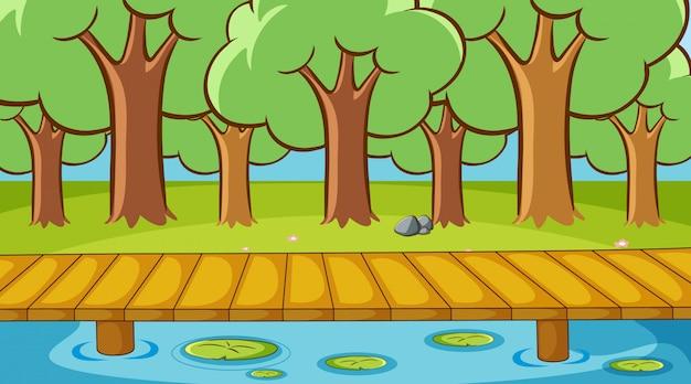 Scène met bomen en rivier in het park