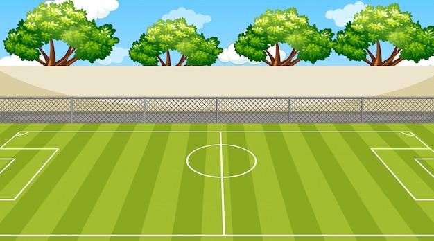 Scène met bomen rond het voetbalveld