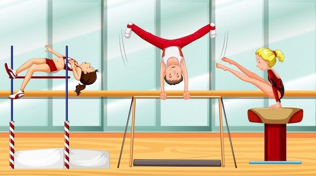 Scène met drie atleten gymnastiek doen