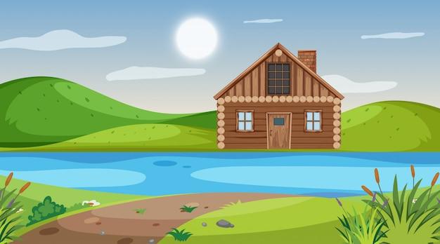 Scène met houten huis aan de rivier over de heuvel