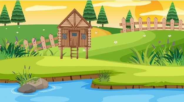 Scène met houten huisje in het veld