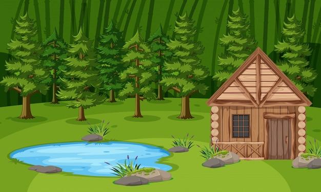 Scène met houten hut door de vijver in het groene bos