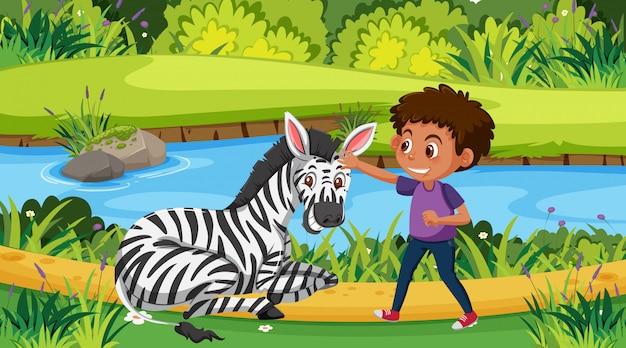 Scène met jongen en zebra in het park