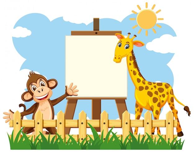 Scène met leeg canvas en gelukkige dieren in het park