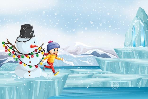 Scène met sneeuwman en meisje