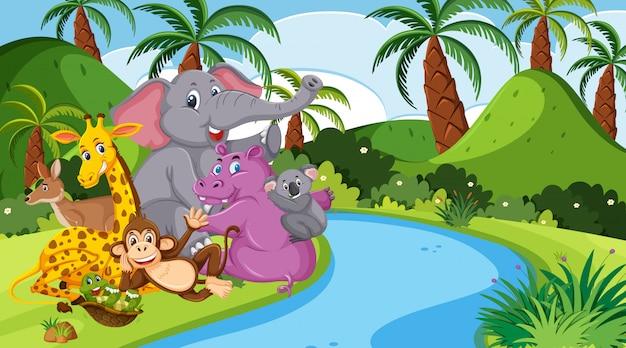 Scène met veel wilde dieren in het bos Premium Vector