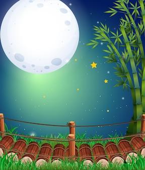 Scène met volle maan over de brug