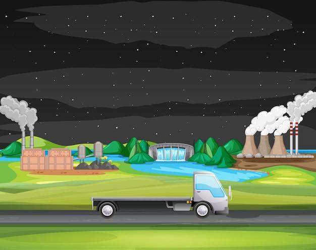 Scène met vrachtwagen die langs het industrieterrein rijdt
